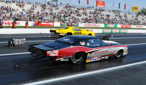 Danny Rowe over a red lighting Troy Coughlin in the finals of Pro Mod