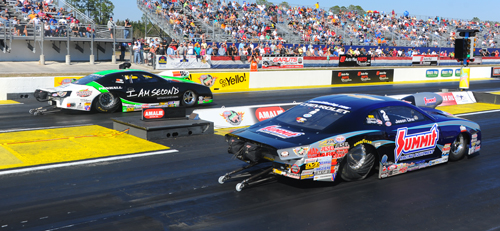 In Pro Stock, Mike Edwards (far lane) is pacing the field with a NHRA record 6.473 at a track record 214.31 MPH. Jason Line is currently #3 with a 6.483