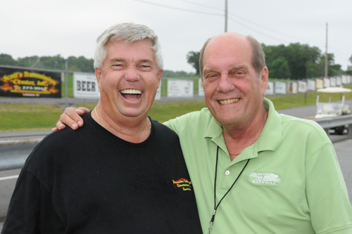 Track manager Lex Dudas and long time racer Roy Hill share a moment at the Grove