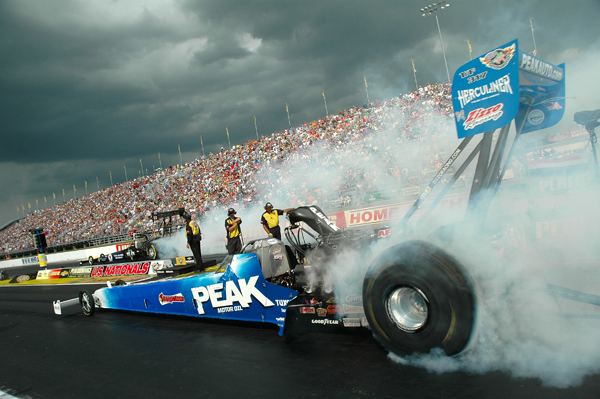 My good Chicago bud Dave O sent me this great image of threatening skies at Indy as Tony Zizzo does a burn out in his Peak Fueler