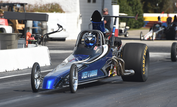 The Livezey and Garbinski Super Comp dragster makes a qualifying pass during Friday's shortened sessiion