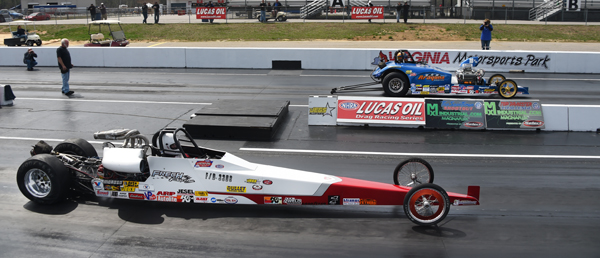 Comp finals had Szupka (far lane) over the dragster of