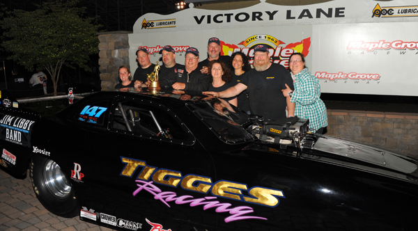 The Tigges team celebrates his first ever NHRA win