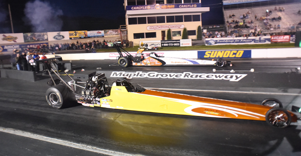 The finals of T/AD had McPhillips (far lane) defeating the blown car of Brandon Greco