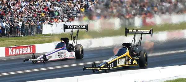 Teammates Tony Schumacher and Antron Brown (far lane) butted heads in R1 with the Sarge taking the win
