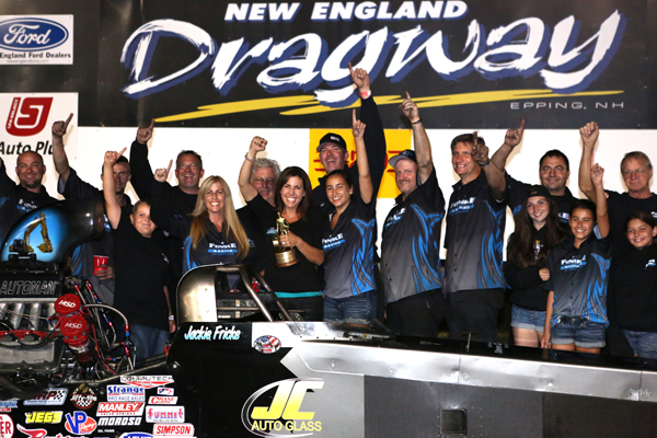 Jackie Fricke's team celebrates her win at the Epping Lucas Oil race