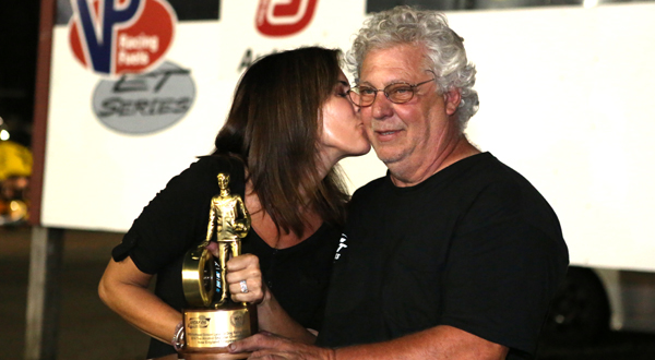 Jackie gives car owner Joe Cantrell and victory kiss