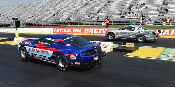 Chris Holbrook (far lane) took his Mustang to a win over Gary Richard in the A Class of Factory