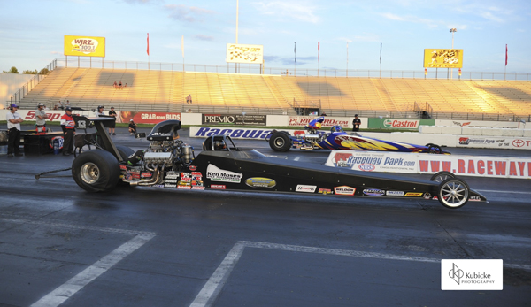 Ken Moses (near lane) defeats  in the finals of Top Dragster