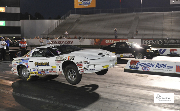 Peter Biondo (near lane) has already wrapped up the 2014 Super Stock title but that did not stop former Super Street champ Michael  from taking the E Town trophy home to