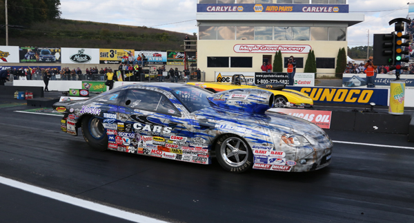 Jason Lynch (near lane) beat Al Kenny for the Super Gas title