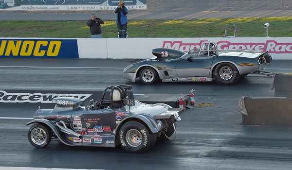 It's Nichols (far lane) over the roadster of  in the finals of Super Gas