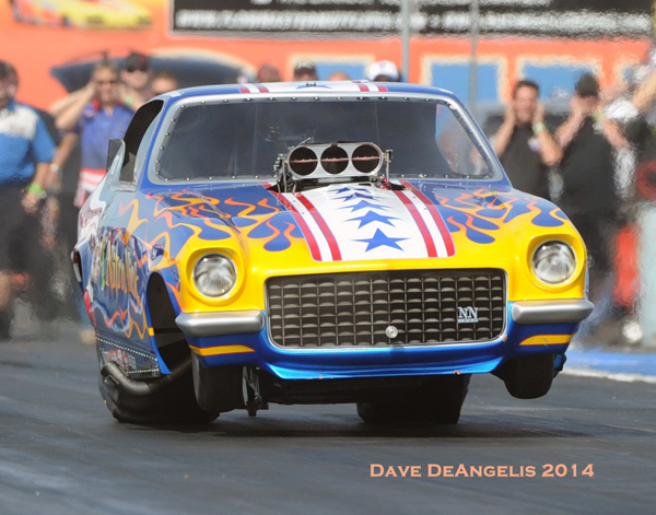 Maple Grove Dragway's Mike Lewis who knows his way around a fuel car, piloted the Nitro Nick Vega to a round 2 finish