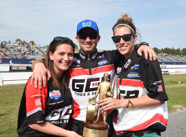 Joe is flanked by Kelly Kundratic and Christina DiBartolomeo after his Gator win