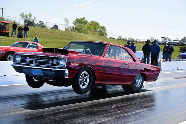 Gary Wolkwitz ran an 8.21 on this pass Friday morning and back it up with a 8.22 for the new SS/AH NHRA record in his 1968 Hemi Dart