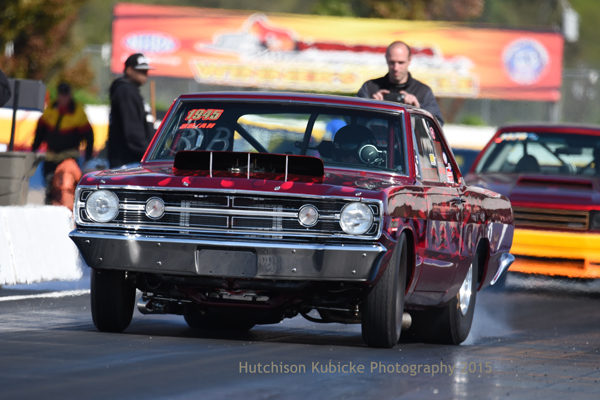 Gary Wolkwitz, after setting the Hemi world on it's ear with a 8.21 during the first session, blew the tires off his Dart in R2. Engine builder David Barton can be seen behind the Mopar