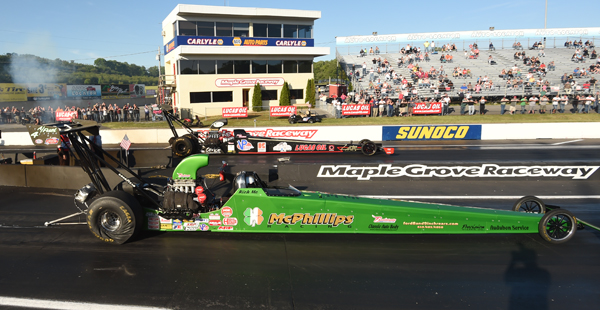 Rich McPhillips (near lane) defeated NHRA T/AD rookie Kara Stricker in the opening round