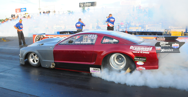 Steve Drumond had a wild ride after his burnout nearly spinning the turbocharged Mustang out and missing the wall in an aborted attempt to make the Pro Mod field
