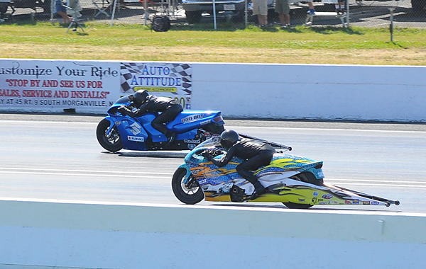 Jerry Savoie (near lane) won Pro Stock Bike when his competition, left too soon in the finals