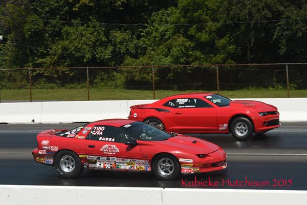 Bubba Linke (near lane) driving his C/SA Camaro defeated the D3 Camaro of